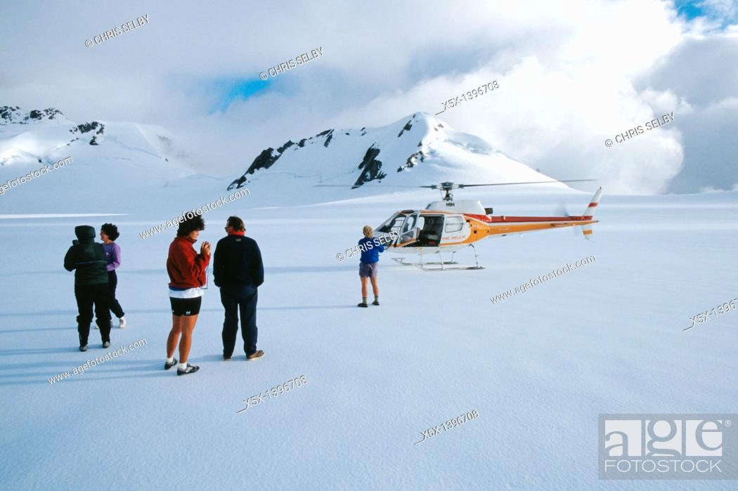 Stock Photo: Group standing outside helicopter on the ice of the neve of Franz Josef Glacier, New Zealand.