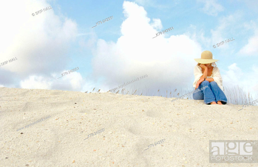 Stock Photo: woman on sand dune.