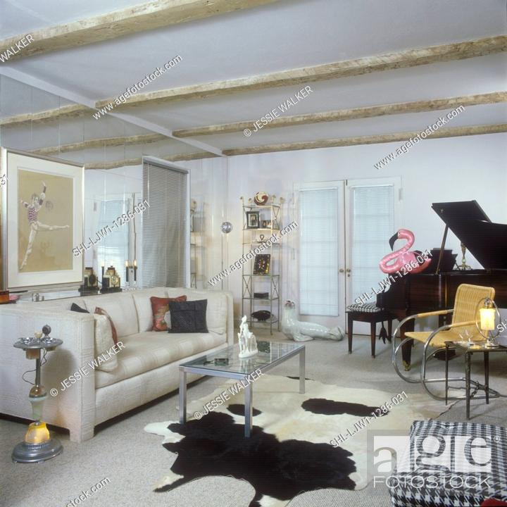 Stock Photo   LIVING ROOM   Black Grand Piano,beige Couch, Pink Flamingo,  Mirrored Wall, Glass And Chrome Coffee Table, Cowhide Rug Chrome And  Leather Chair ...