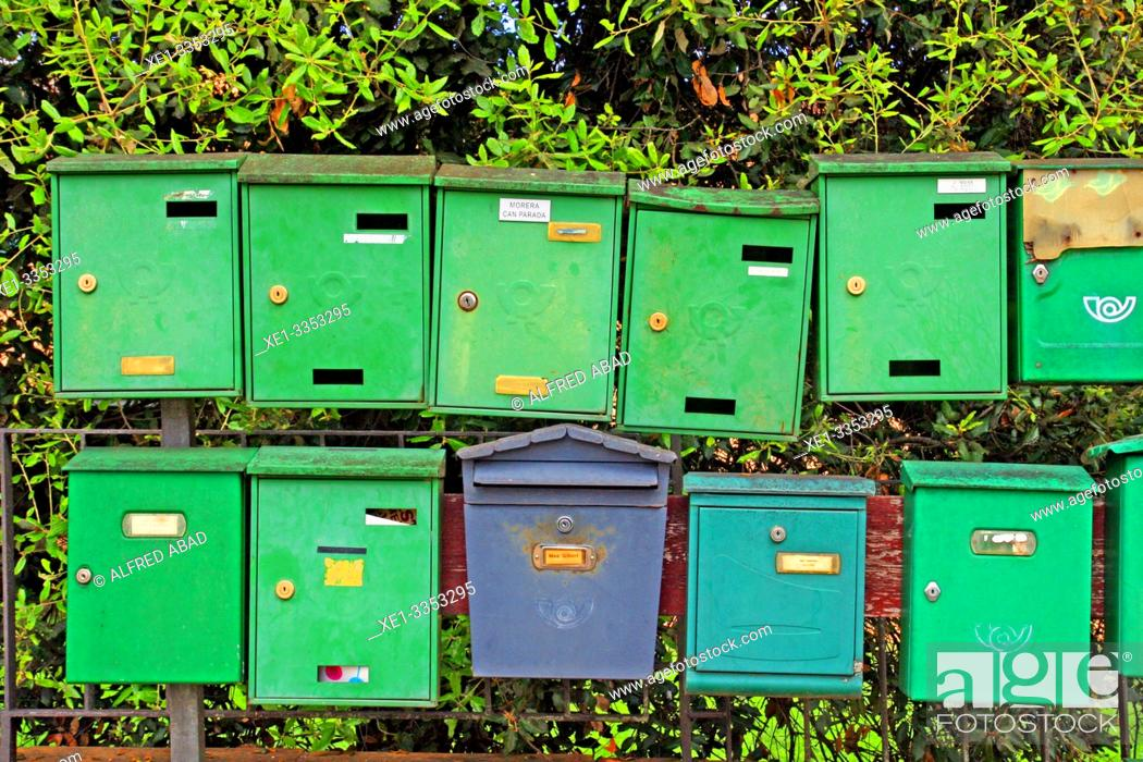 Photo de stock: green and blue mailboxes, Sant Gregori, Vall de Llémena, Girona, Catalonia, Spain.