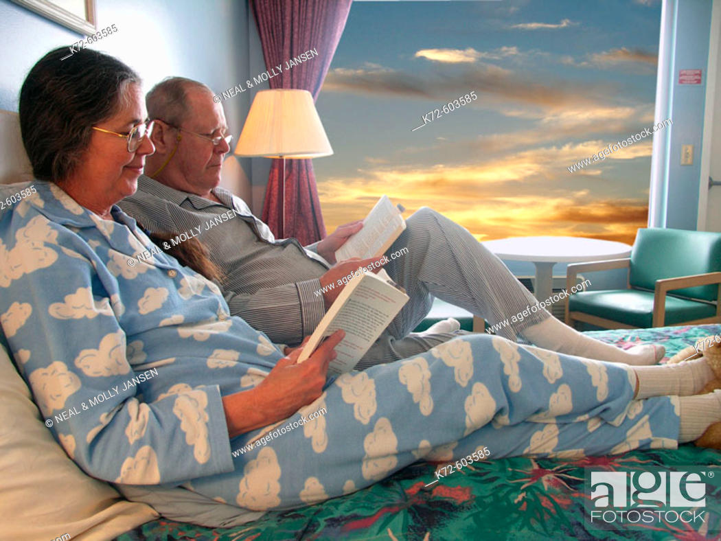 Stock Photo: Older Couple Lounging Together on Bed.