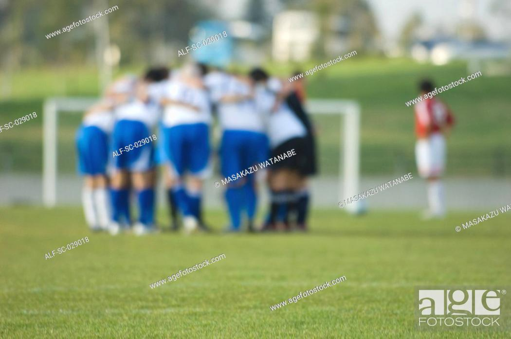 Stock Photo: Soccer Team Huddling.