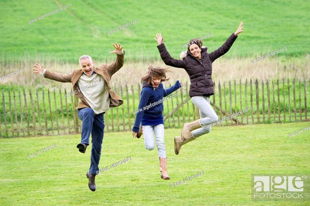 Stock Photo: Happy family having fun in a field.