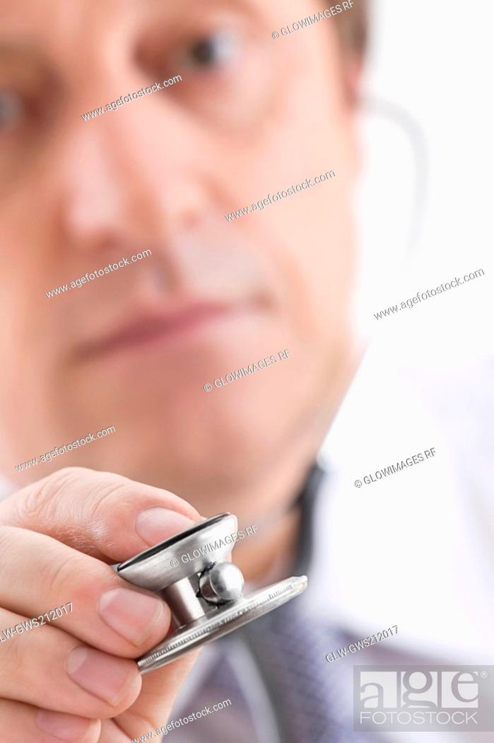 Stock Photo: Close-up of a male doctor holding a stethoscope.