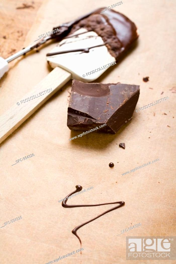 Stock Photo: Piece of chocolate, remains of couverture, baking utensils.