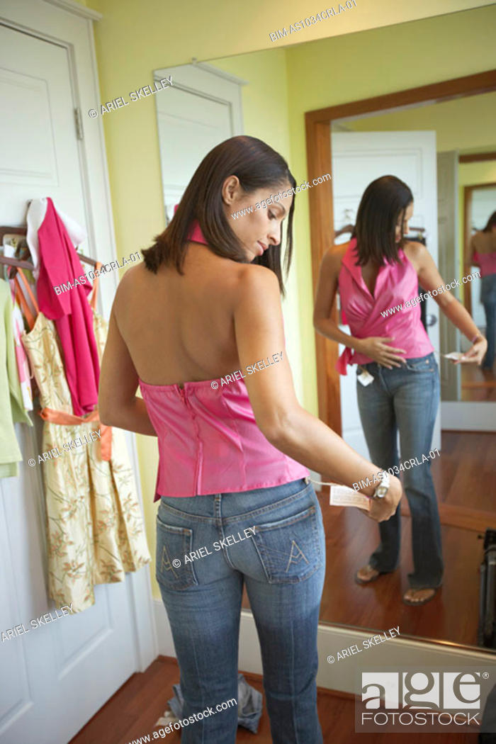 Stock Photo: Woman trying on clothing.