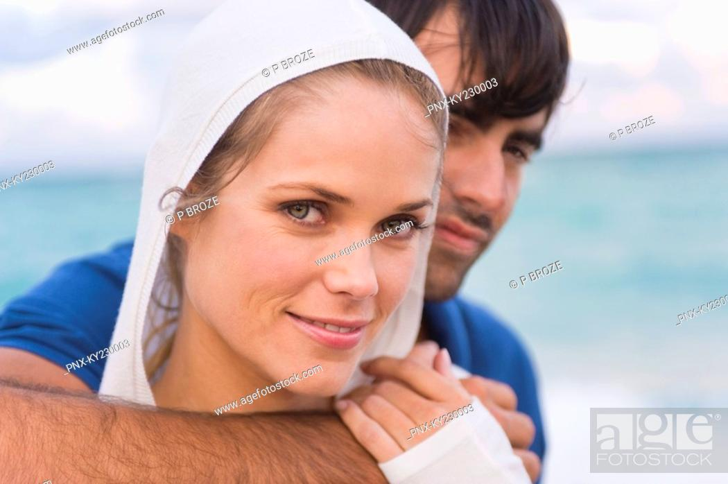Stock Photo: Couple smiling on the beach.
