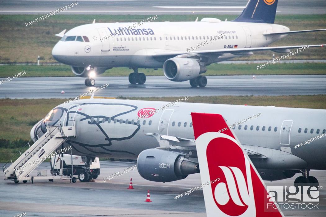 Stock Photo: A plane of the airline Lufthansa rolls along the runway past planes of the airlines Niki and Air Berlin at the airport in Duesseldorf, Germany, 1 December 2017.