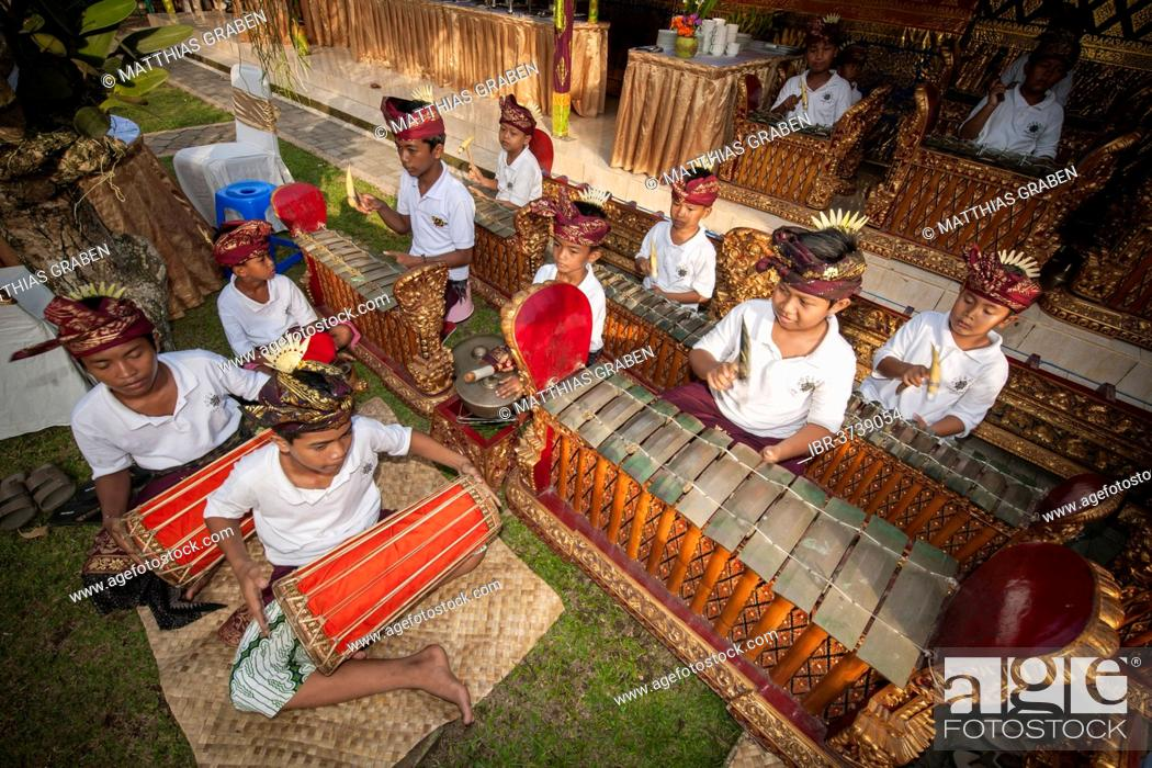 Stock Photo: Children and teenagers of a gamelan orchestra at an event, Ubud, Bali, Indonesia.