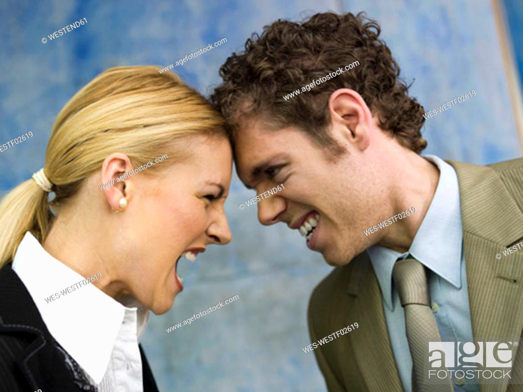 Stock Photo: Businessman and businesswoman quarrelling, side view, close up.