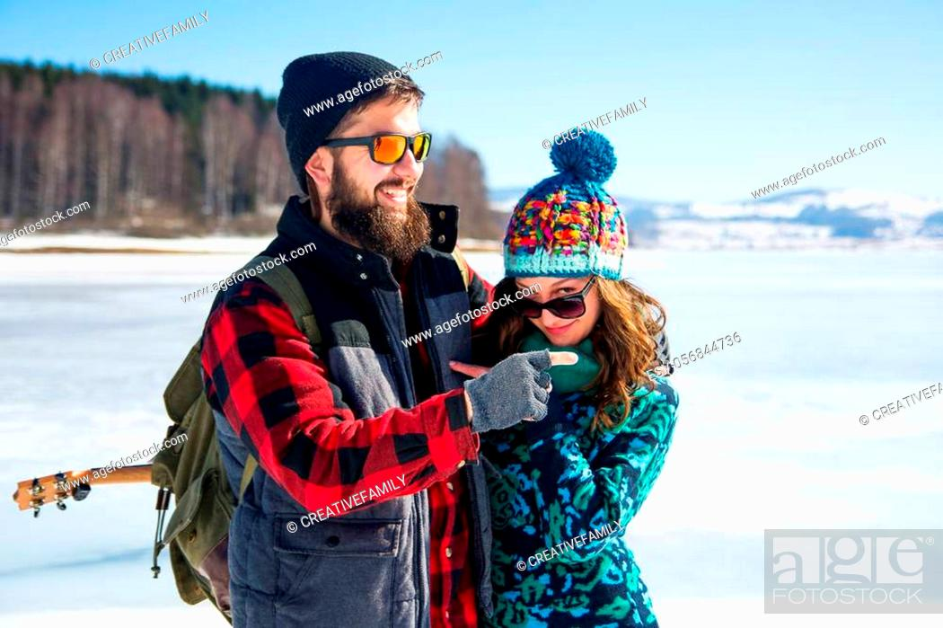 Stock Photo: Couple enjoying the day on a frozen lake surface.