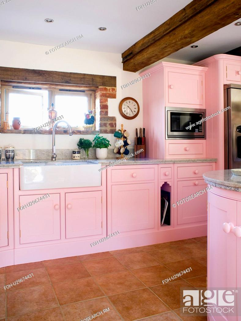 Pastel Pink Fitted Units And Cupboards In White Country Kitchen