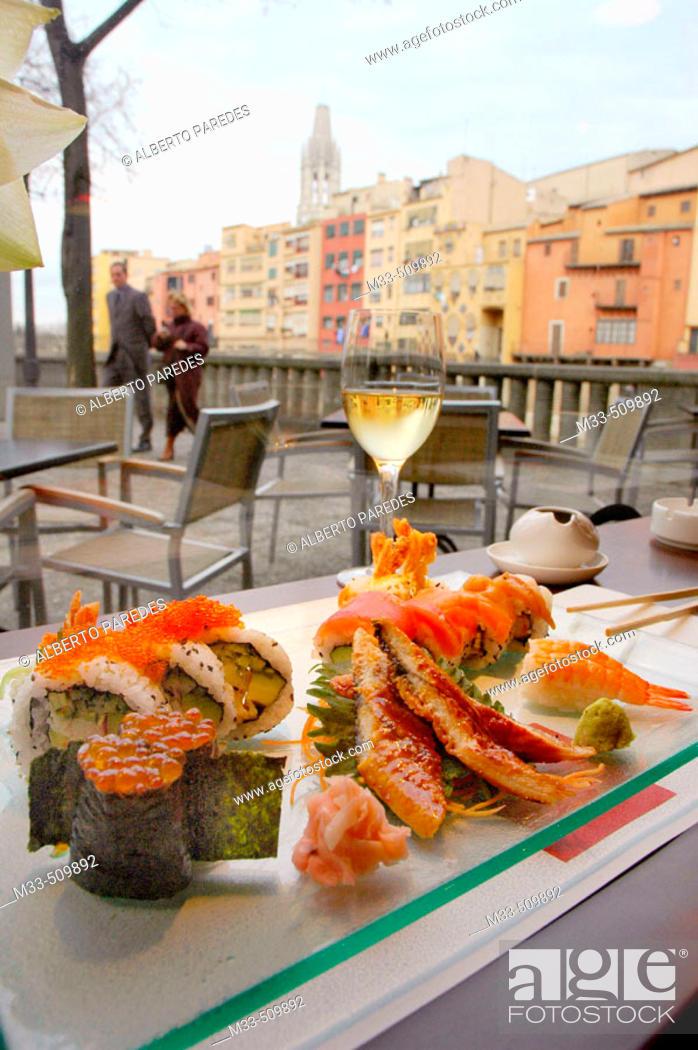 Stock Photo: Sushi.'Riba-Sushi Bar'. Houses by Onyar river and Sant Feliu Church in background. Girona, Catalonia , Spain.