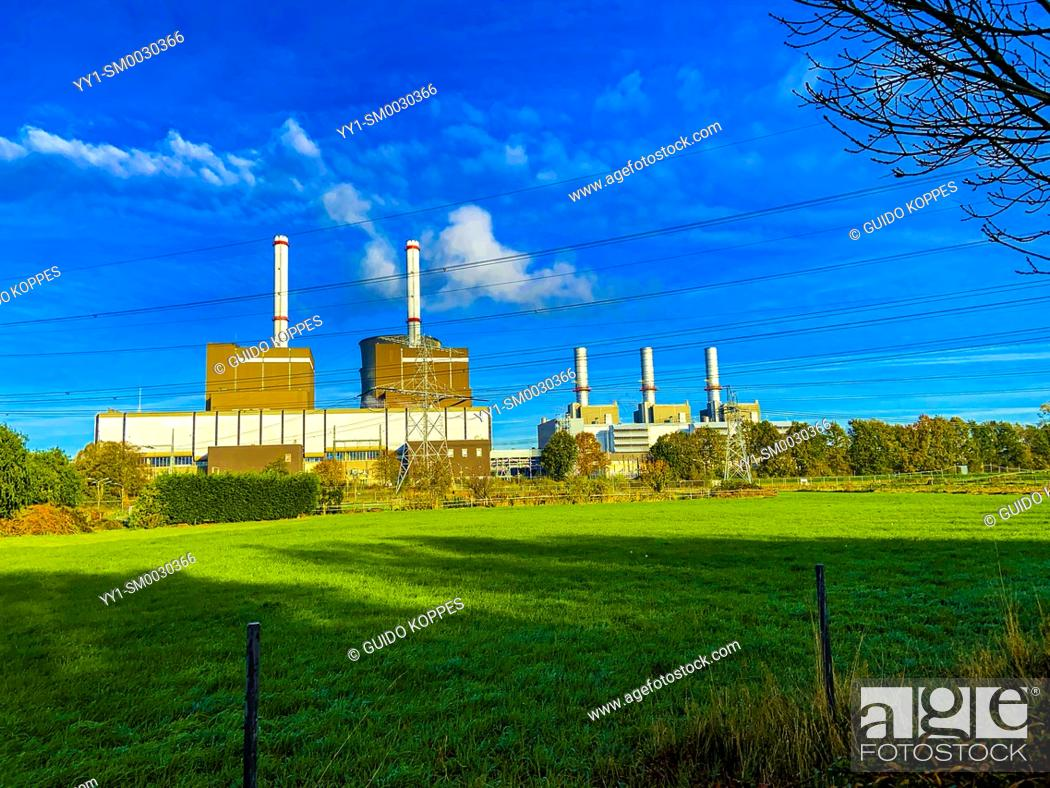 Stock Photo: Brachterbeer, Netherlands. Rural, Polder Landscape with the Inudstrial Prince Claus Power Plant still working on Fossil Fuels.