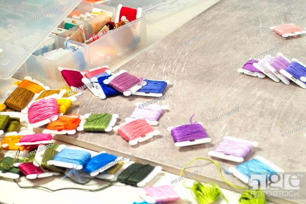 Stock Photo: needle, sewing intrument, house item, bobbin, thread.