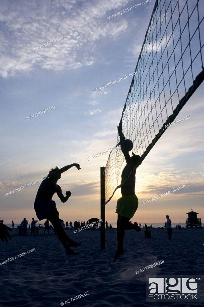 Stock Photo: Beach volleyball match at sunset.