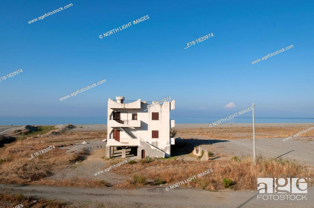 Stock Photo: Italy, Calabria  Strange lone apartment building near the shre of the Tyrrhenian Sea.