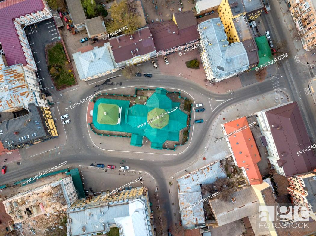 Stock Photo: Top view of the dome of the Church of St. Nicholas Pristika, the roofs of houses and the road with parked cars, the district Podol. Kiev, Ukraine.