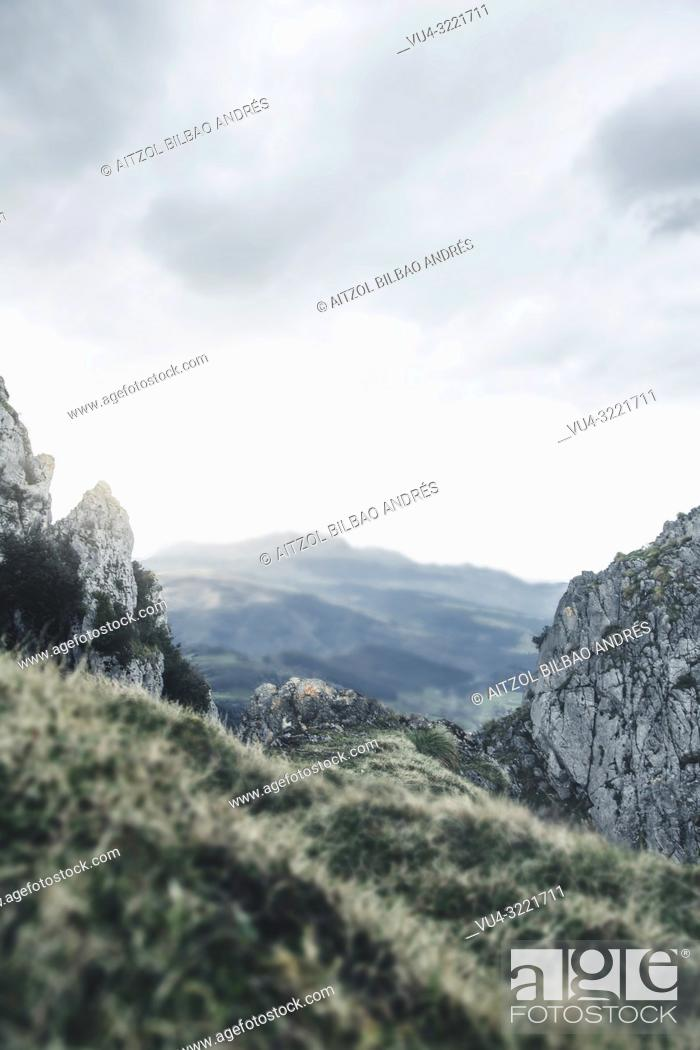 Stock Photo: This shot is perfect to place a person into it, I have a version of me in the center of the rock. Basque mountains.