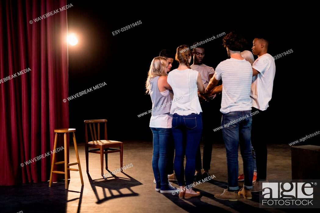 Stock Photo: Actors team forming their hands stacked.