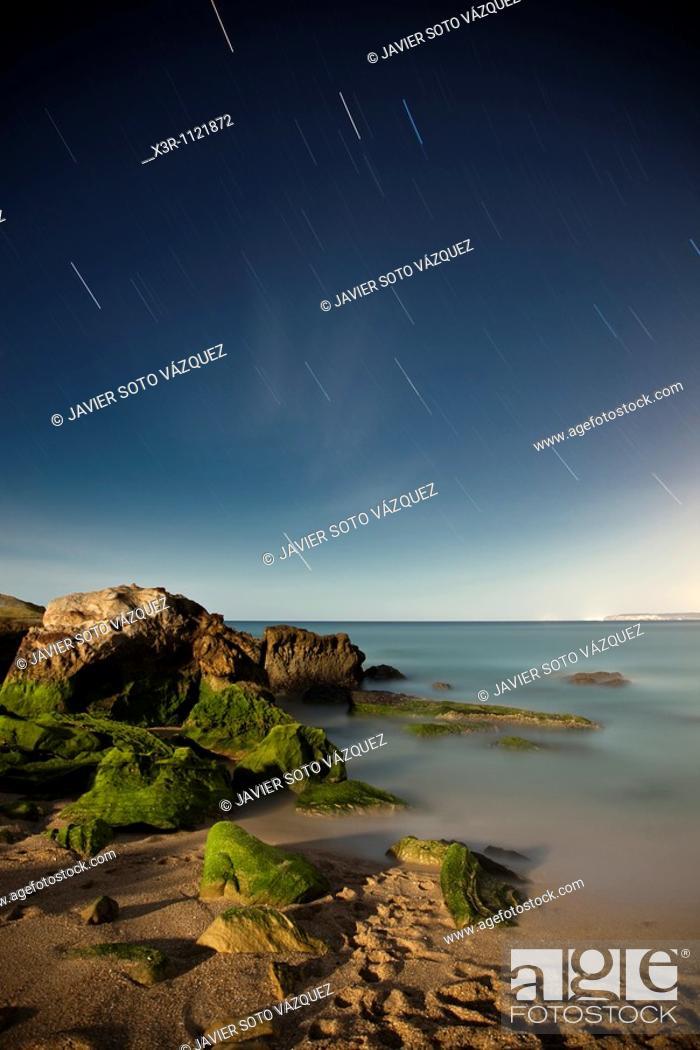 Stock Photo: Starry Night on a rocky coast.
