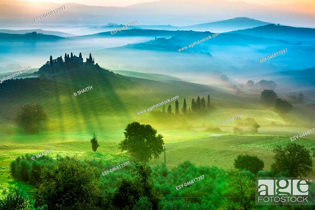 Photo de stock: Beautiful view of green fields and meadows at sunset in Tuscany.