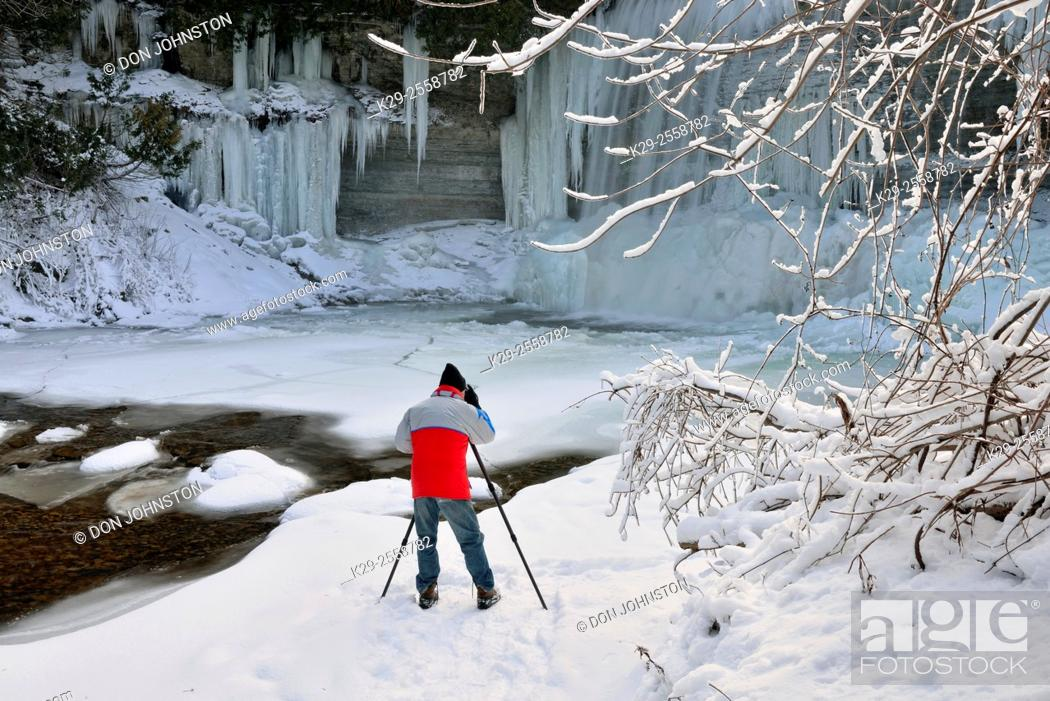 Stock Photo: Photographer below Bridal Veil Falls and the Kagawong River in Winter, Kagawong, Manitoulin Island, Ontario, Canada.