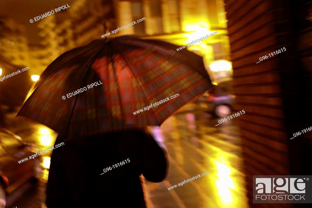 Stock Photo: people with umbrella.