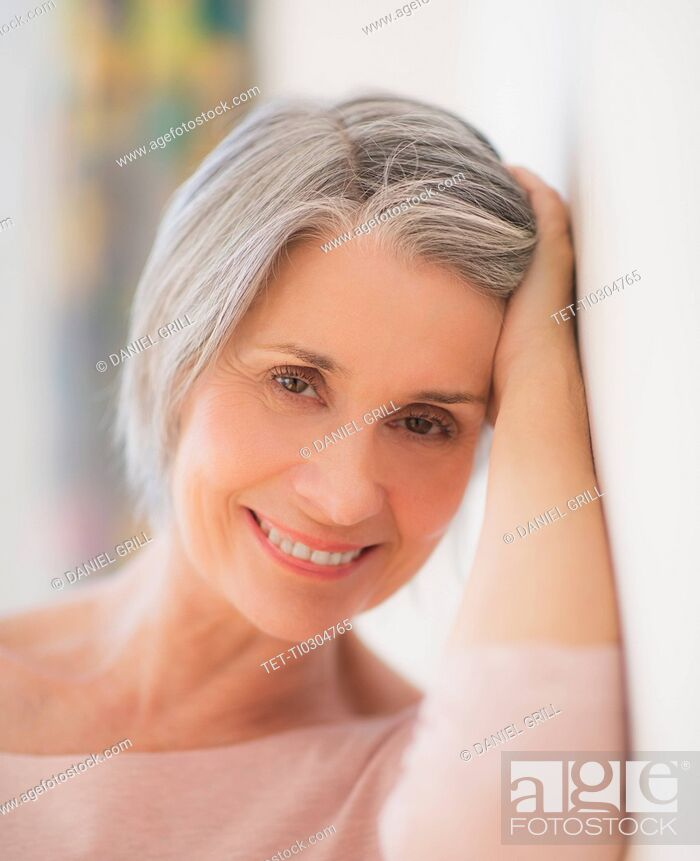 Stock Photo: Portrait of relaxed woman leaning against wall.