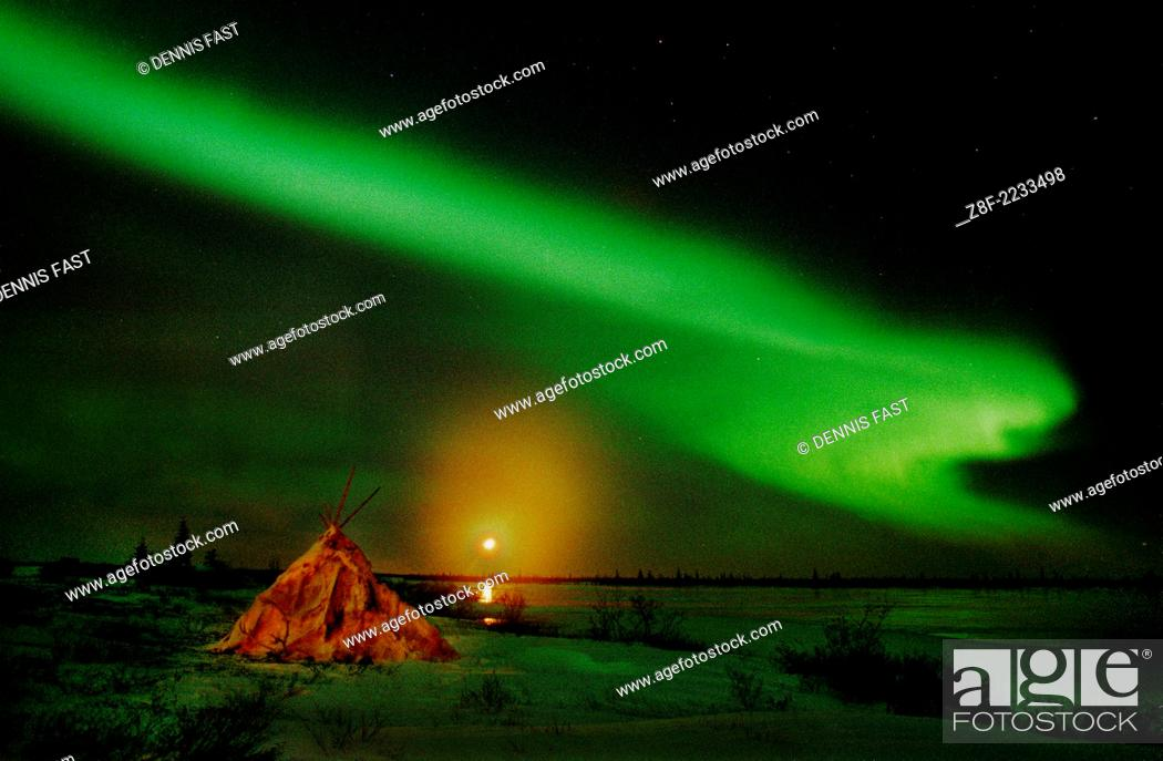Stock Photo: Aurora Borealis Northern Lights full moon over wigwam caribou skin tepee near Churchill, Manitoba, sub-arctic, Hudson Bay, Northern Canada.