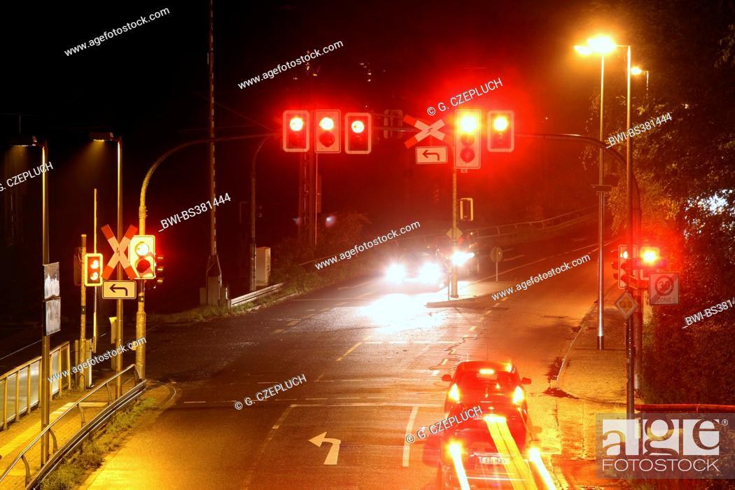 crossing with traffic signs and railroad crossing the