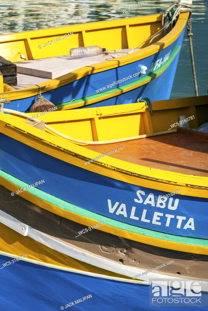 Stock Photo: maltese traditional colorful painted luzzu boats in marsaxlokk fishing village malta.