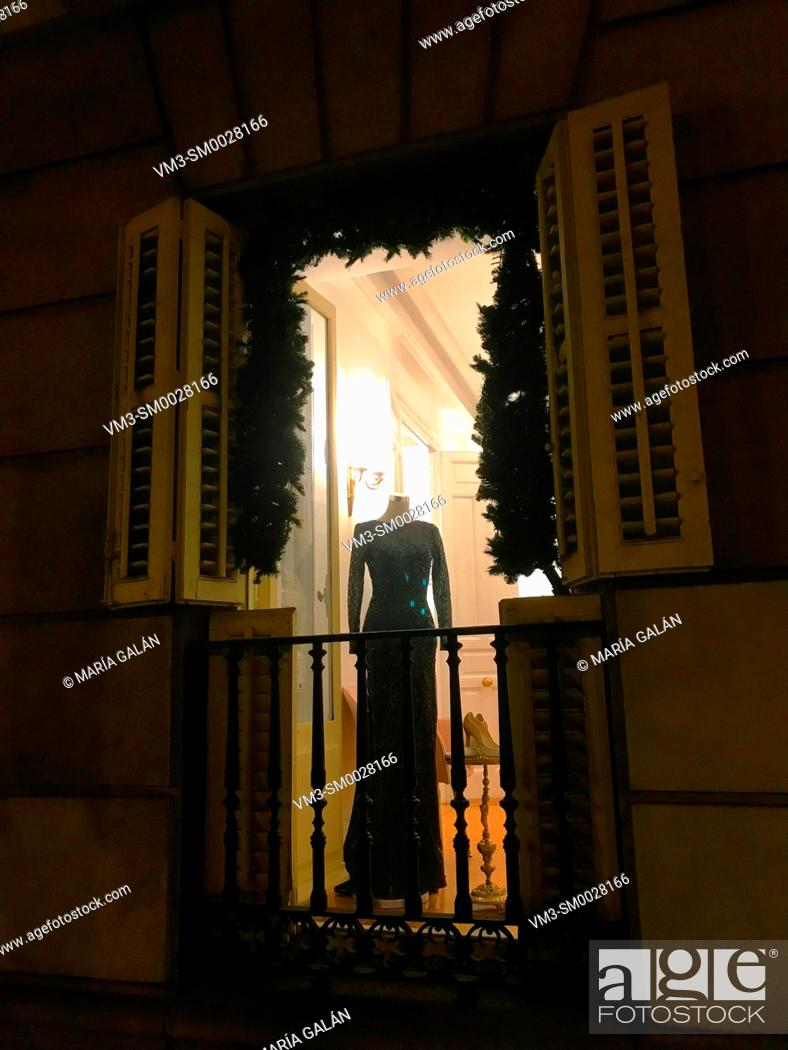 Stock Photo: Mannequin in a balcony, night view. Madrid, Spain.