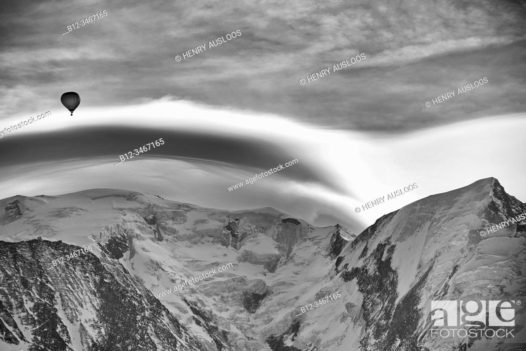 Stock Photo: France, Haute-Savoie (74), Alps, Mont Blanc mountain range, lenticular cloud and hot air balloon.