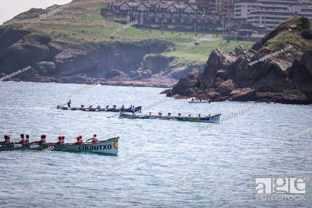 Stock Photo: CASTRO URDIALES, SPAIN - JULY 15, 2018: Competition of boats, regata of trainera, Ondarroa Cikautxo, Cabo, Donostiarra and Santurtzi Iberdrola boats in action.