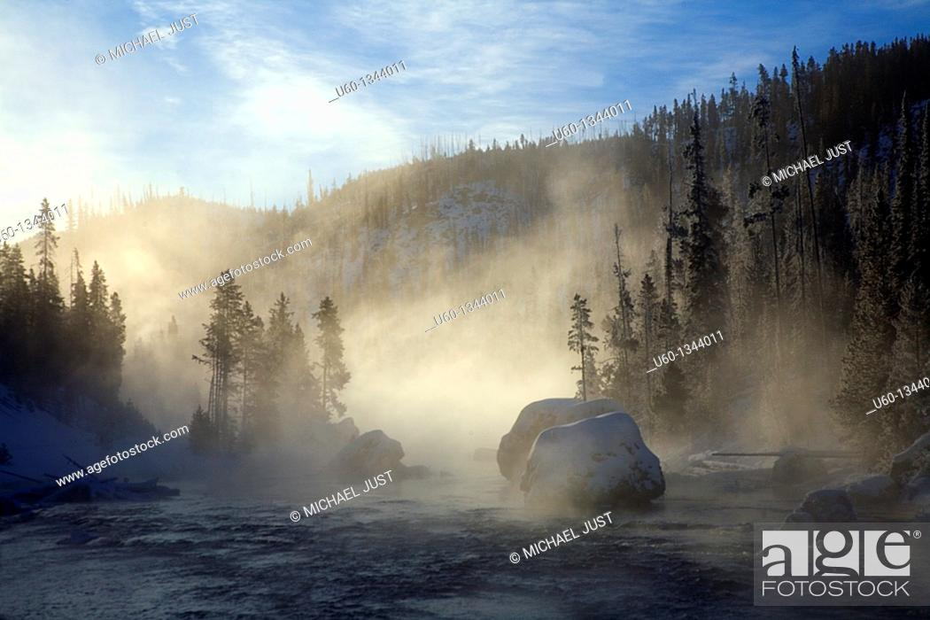 Stock Photo: Cold temperatures produce steam from the Firehole River at Yellowstone National Park, Wyoming.