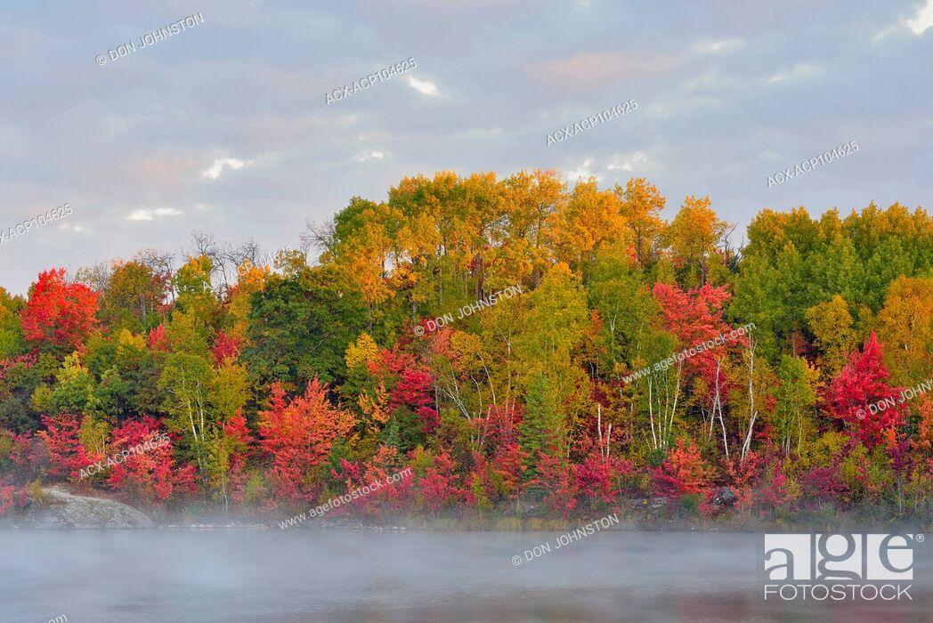 Stock Photo: Autumn reflections in misty St. Pothier Lake, Greater Sudbury, Ontario, Canada.