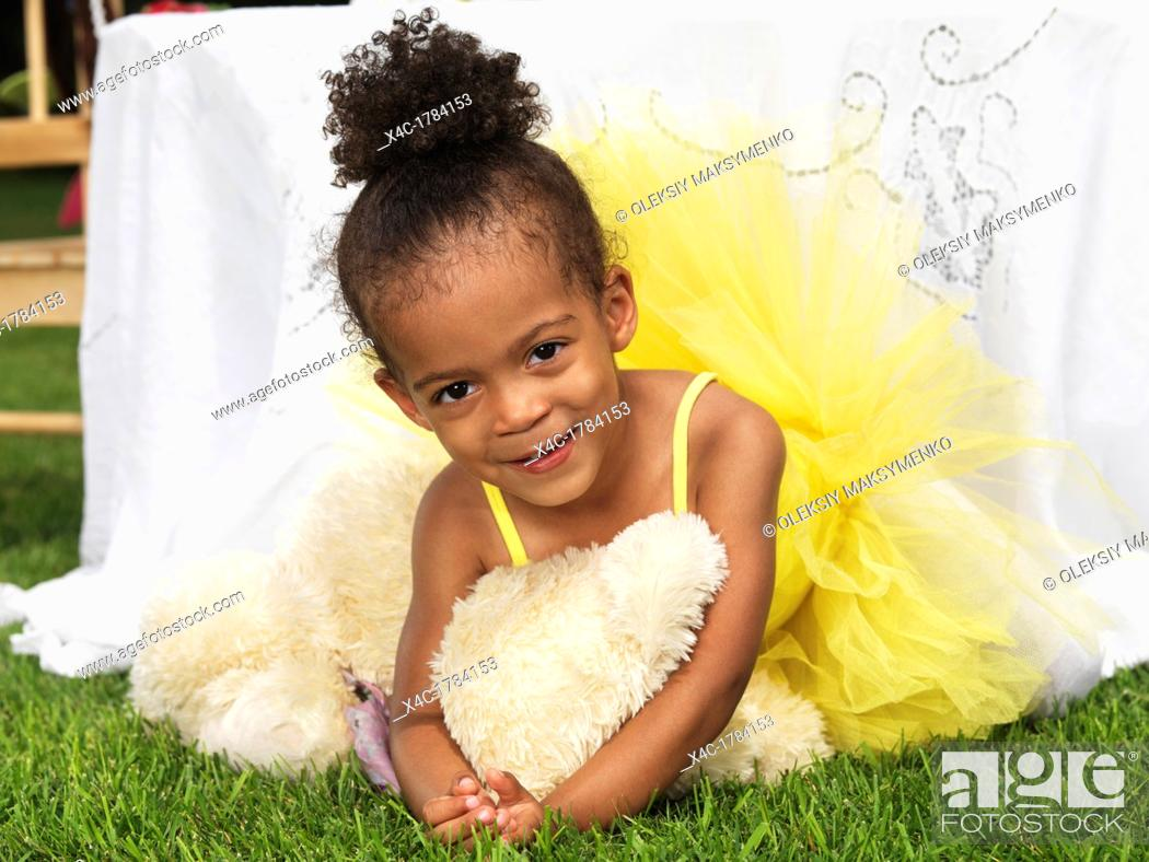 9d18b9dd32fc Portrait of a cute smiling three year old black girl at a party ...