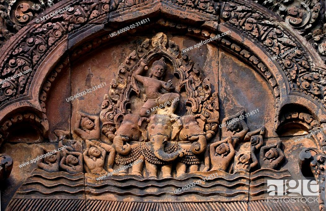 Stock Photo: Bas relief in red sandstone of Indra riding his three headed elephant on the East Pediment of the North Library at Banteay Srei.