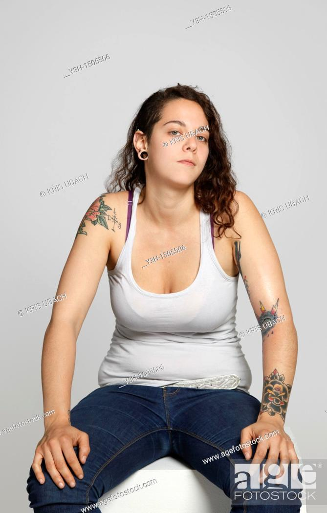 Stock Photo: Studio shot of woman with tattoos.