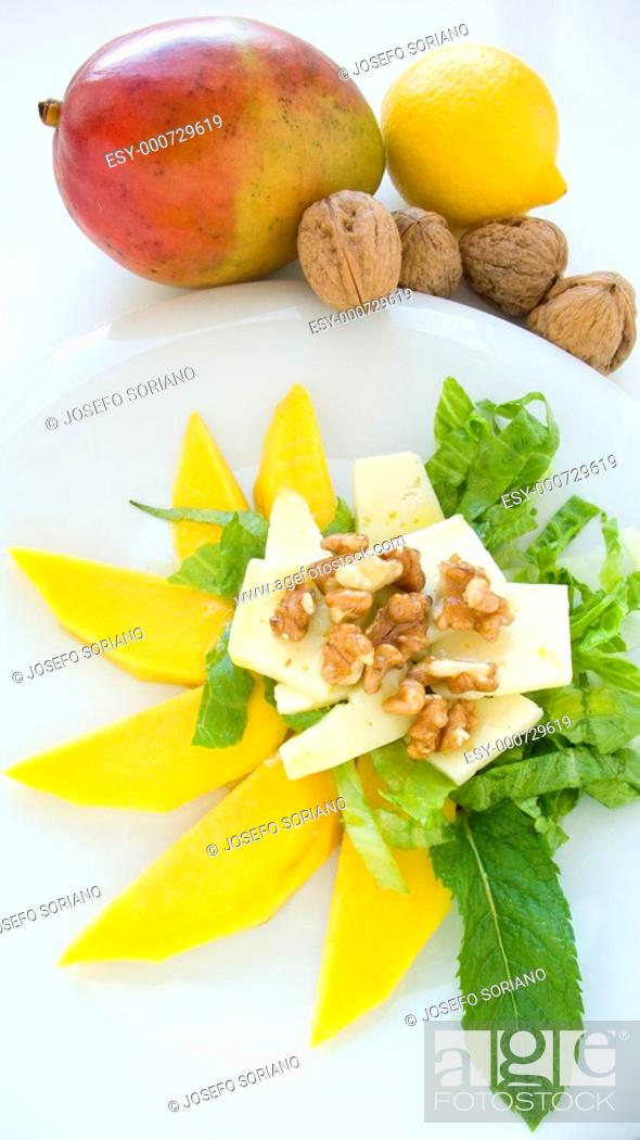 Stock Photo: Salad with cheese, mango, lettuce, lemon and mint leaves.