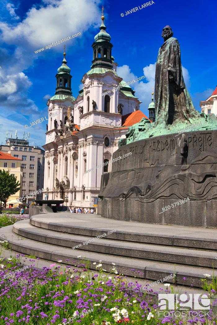Stock Photo: St. Nicholas Church and Jan Hus Memorial in Staromestske Namesti (Old Town Square), Prague, Czech Republic, Europe.