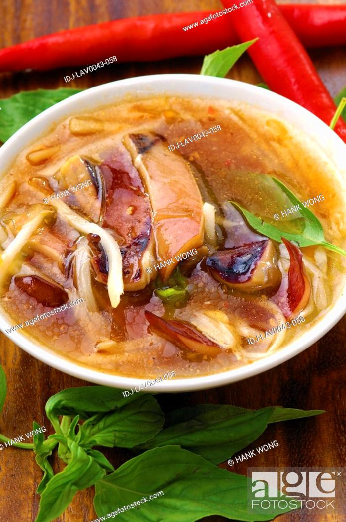 Stock Photo: High angle view of Oriental squid and noodle soup.