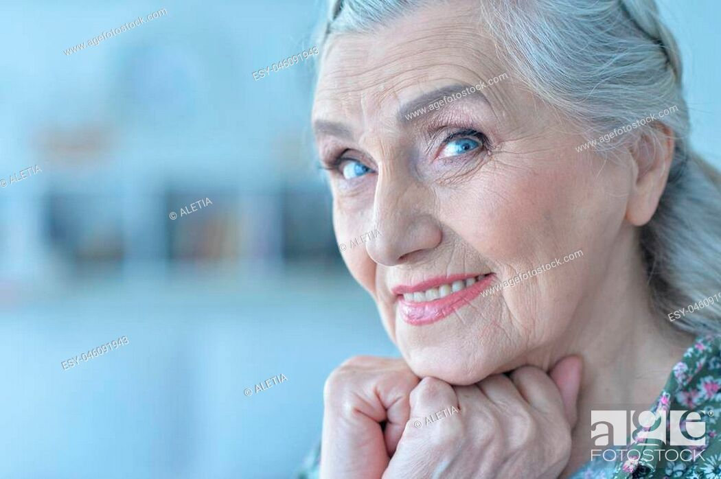 Stock Photo: close up portrait of beautiful happy senior woman at home.