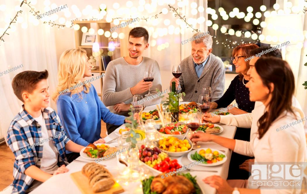 Stock Photo: happy family having dinner party at home.