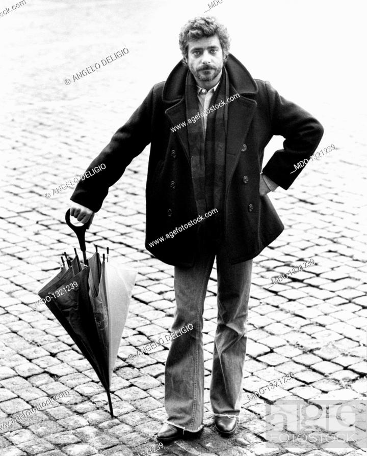Stock Photo: Portrait of Giancarlo Giannini with an umbrella in his hands. Portrait of the Italian actor and voice actor Giancarlo Giannini with an umbrella in his hands.