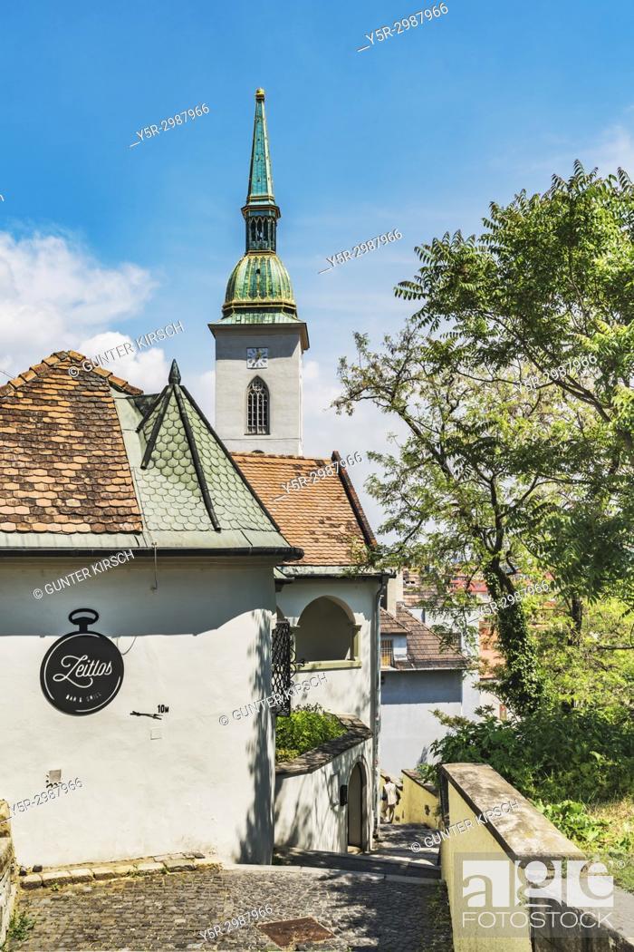Stock Photo: Walk away from Bratislava Castle via the castle stairs (Zamocke schody) to St. Martins Cathedral. The St. Martins Cathedral, the Cathedral of St.
