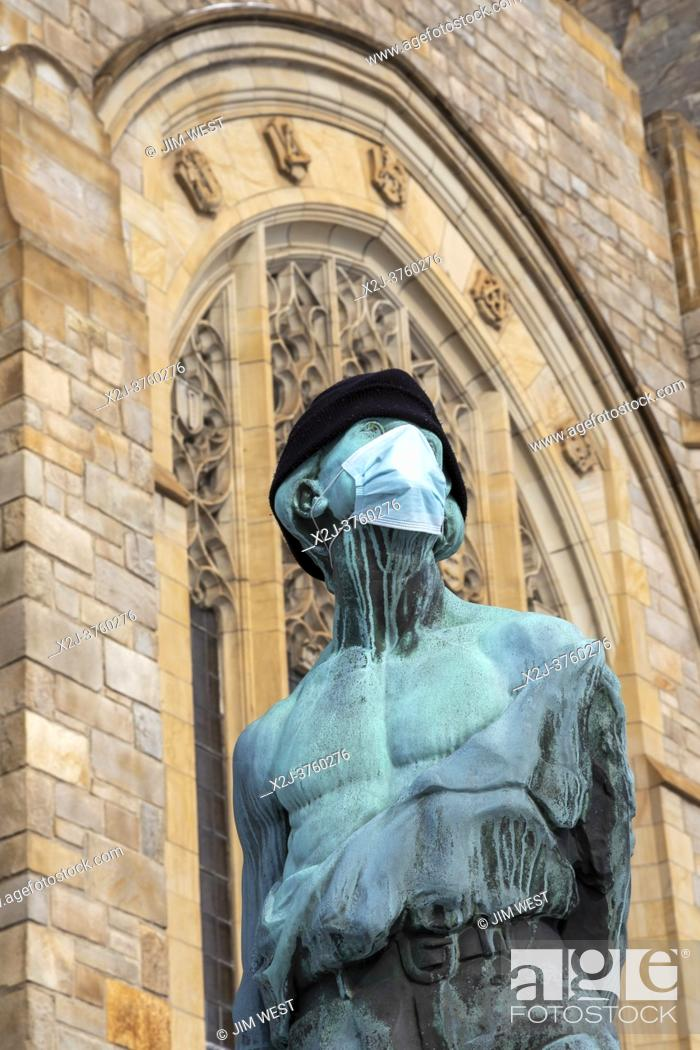 Stock Photo: Detroit, Michigan - A statue outside the Metropolitan United Methodist Church wears a face mask during the Covid-19 pandemic.