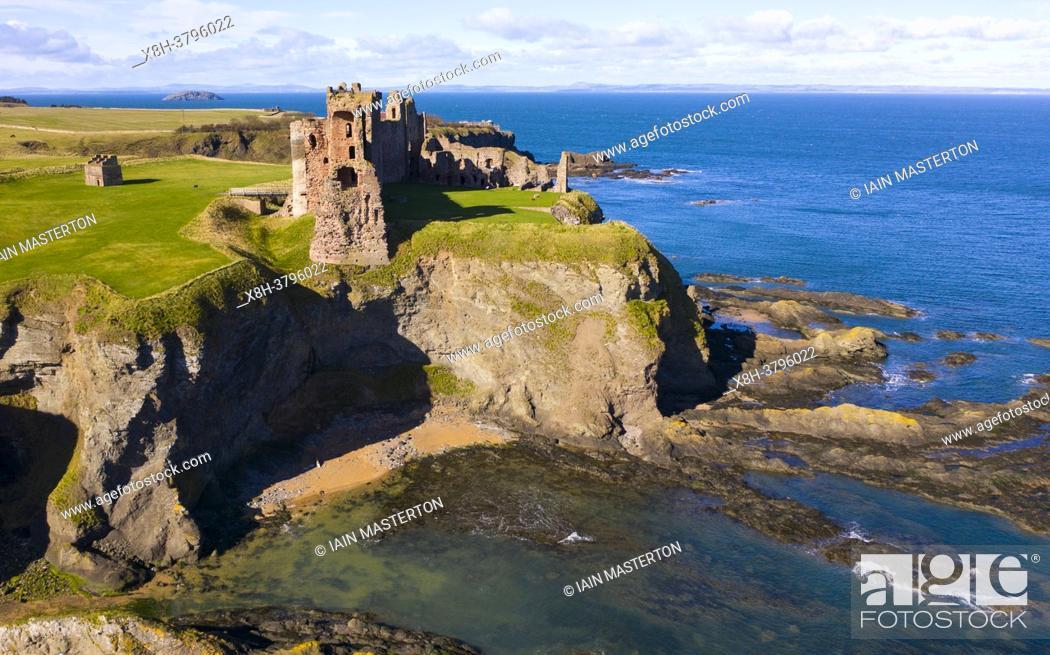 Stock Photo: Aerial view of Tantallon Castle on sea cliffs coast in East Lothian Scotland UK.