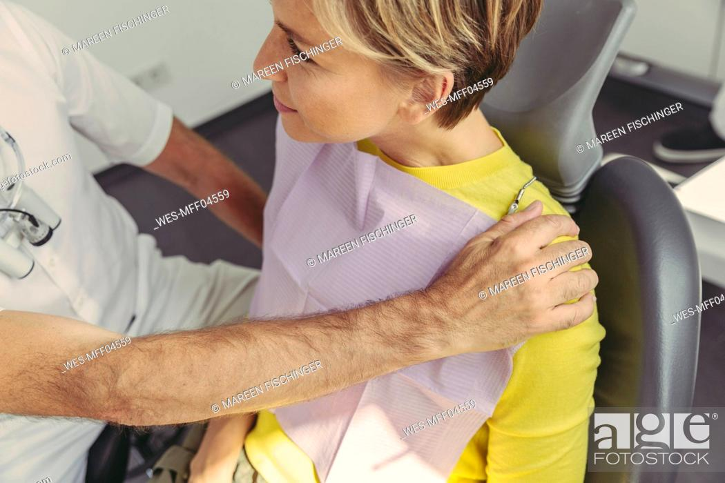 Stock Photo: Dentist calming his patient before treatment.